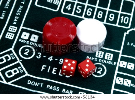 Photo of Dice and Chips on a Craps Table.