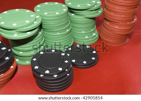photo of different colours casino chips stacks