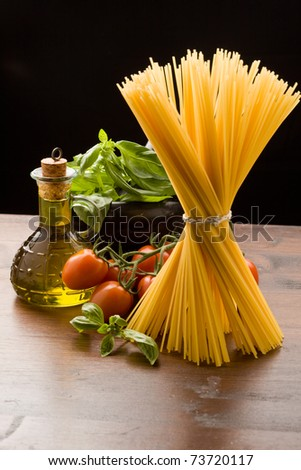 photo of different ingredients for italian pasta with tomatoes and basil