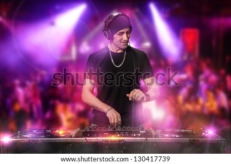 Photo of dj working at the disco - stock photo