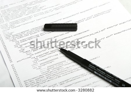 Photo of document with web code and pen - stock photo