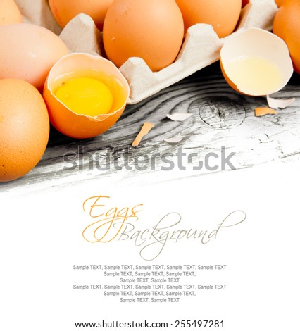 Photo of eggs in a cardboard on wooden board with white space for text