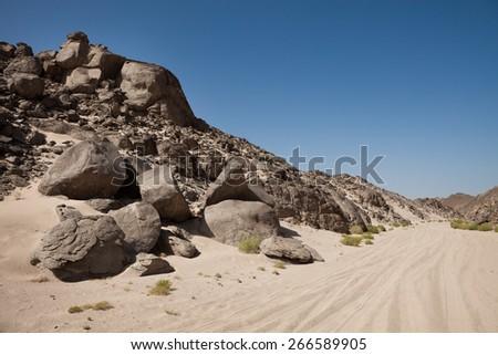Photo Of Egyptian Desert With Mountains Range - stock photo