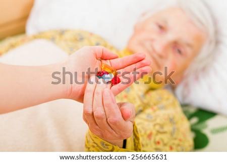 Photo of elderly woman taking the medication - stock photo
