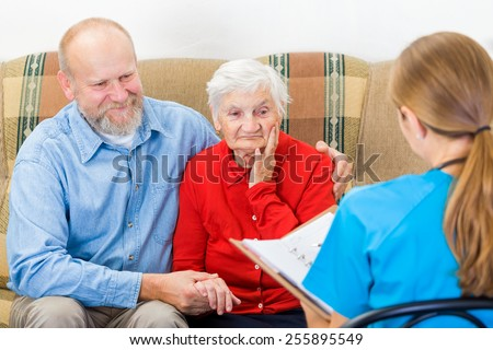 Photo of elderly woman tells a story for the doctor - stock photo
