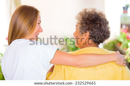 Photo of elderly woman with her daughter - stock photo