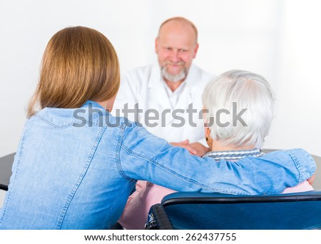 Photo of elderly woman with her grandchild at the doctor