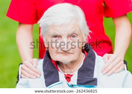 Photo of elderly woman with the caregiver - stock photo