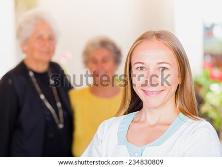 Photo of elderly women and their carer - stock photo