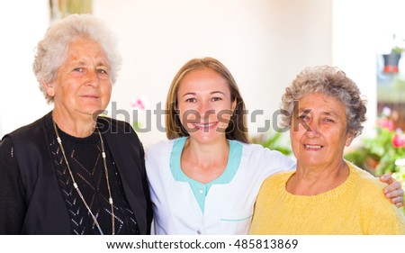 Photo of elderly women and their carer