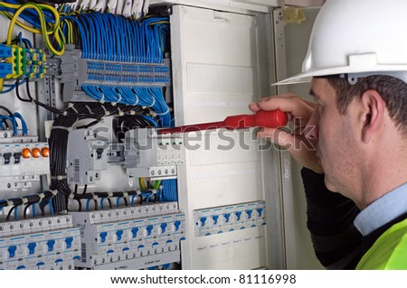 Photo of electrician during measurement - stock photo
