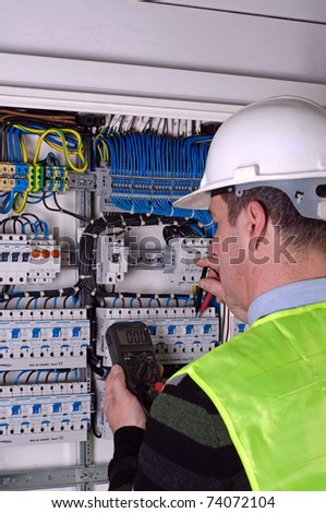 Photo of electrician during measurment - stock photo