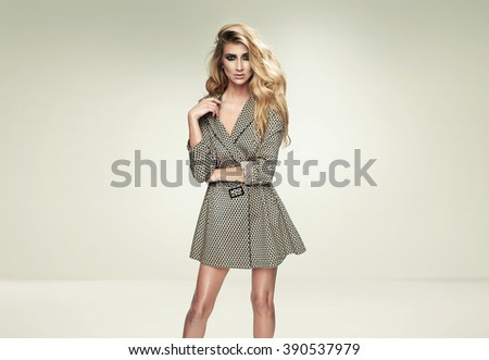 Photo of elegant blonde girl with amazing long hair - stock photo
