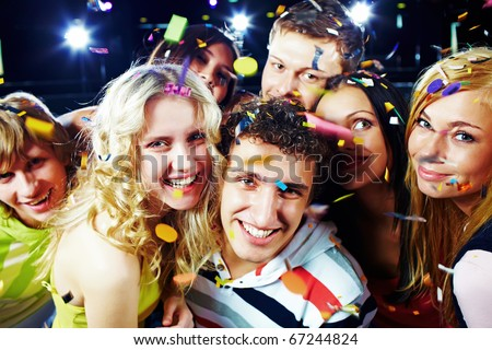 Photo of emotional teenagers laughing while having great party - stock photo