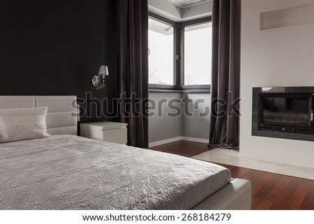 Photo of exclusive bedroom in modern residence - stock photo