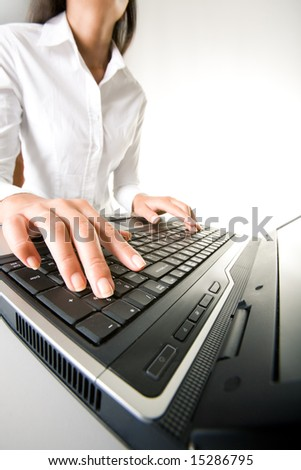 Photo of executive businesswomanâ??s hands on keyboard of laptop while typing documents - stock photo