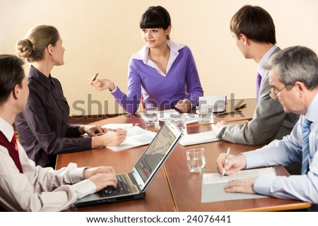 Photo of executive partners communicating with each other at briefing - stock photo
