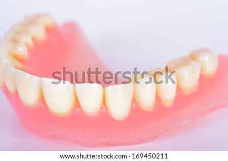 Photo of false teeth  - stock photo