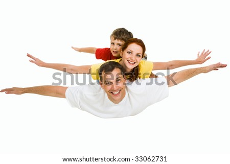 Photo of family flying together on a sky background