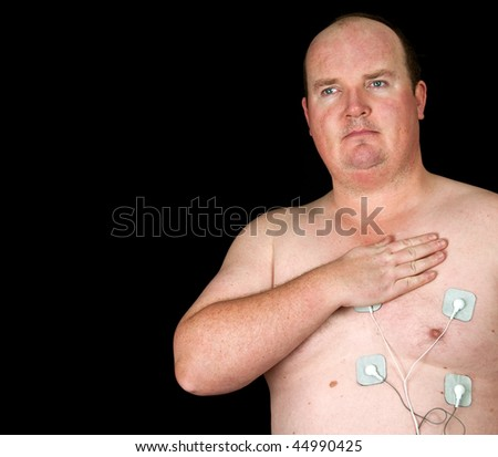 photo of fat male with chest pain and electrode tens patches - stock photo