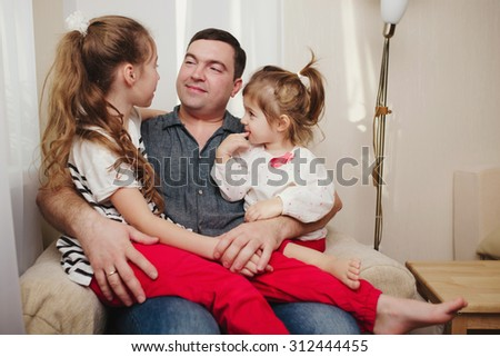 photo of father with daughter at home - stock photo