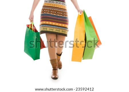 Photo of female going with paperbags in both hands - stock photo