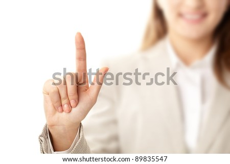 Photo of female hand with forefinger pointing upwards - stock photo