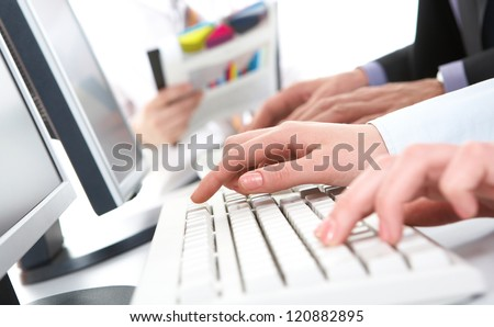 Photo of female hands pushing keys of keyboard - stock photo