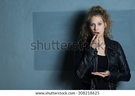 Photo of female with mental problem taking drugs - stock photo