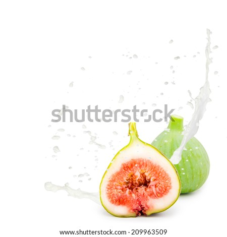 Photo of fig with milk splash isolated on white