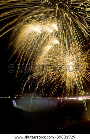 Photo of Fireworks over Niagara Falls, Ontario, Canada. Part of the 2011/2012 Winter Festival of Lights. - stock photo