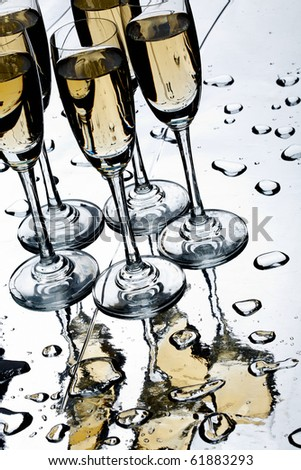 Photo of flutes of champagne placed on the table - stock photo
