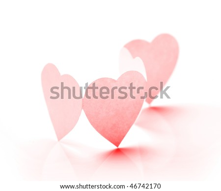 Photo of four paper hearts in chain. Closeup. Toned in red. - stock photo