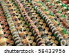 Photo of fresh maki sushi platter with a lot of variety. Selective focus on middle of the platter. - stock photo