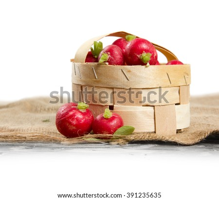 Photo of fresh radish in a basket with white space
