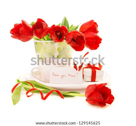 Photo of fresh red tulip flowers in vase and cup of coffee isolated on white background, morning beverage for dear mom, greeting postcard, mothers day, still life, gift box, love concept - stock photo