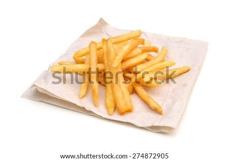 Photo of fried potatoes closeup on brown paper on white background