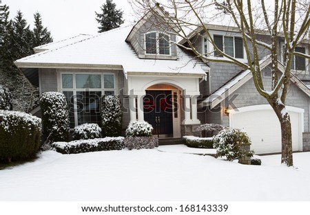 Photo of front yard of home during the holidays with fresh snow fallen that morning - stock photo
