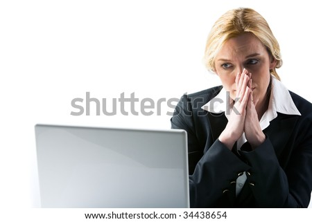 Photo of frustrated businesswoman looking at laptop display and thinking at work - stock photo