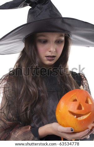 Photo of girl in halloween costume and holding a pumpkin - stock photo