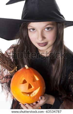 Photo of girl in halloween costume,  broom and pumpkin