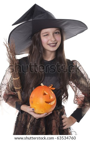 Photo of girl in halloween costume,  broom and pumpkin and blinking eye - stock photo