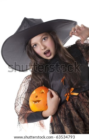 Photo of girl in halloween costume,  broom and pumpkin with scared face - stock photo