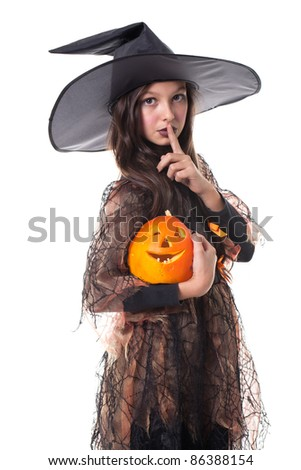 Photo of girl in halloween costume holding a pumpkin on the hand and making silence sign
