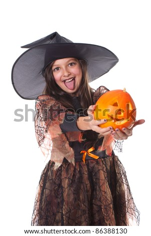 Photo of girl in halloween costume holding a pumpkin on the hands and making funny face