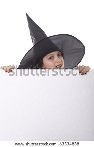 Photo of girl with a  halloween hat behind a billboard - stock photo