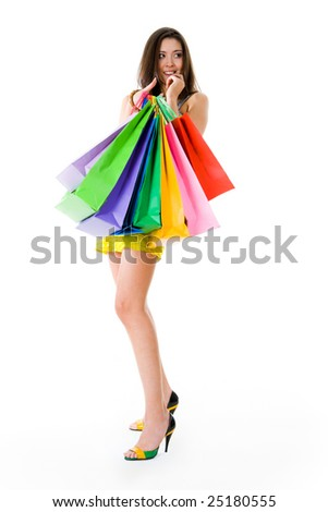 Photo of glamorous shopper with lots of bags isolated on white background - stock photo