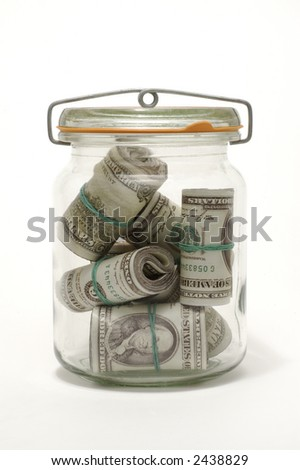 Photo of Glass Bank with Money. Close up of dollar . - stock photo