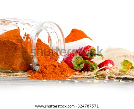 Photo of glass spicebox full of ground pepper spice on burlap with white space - stock photo