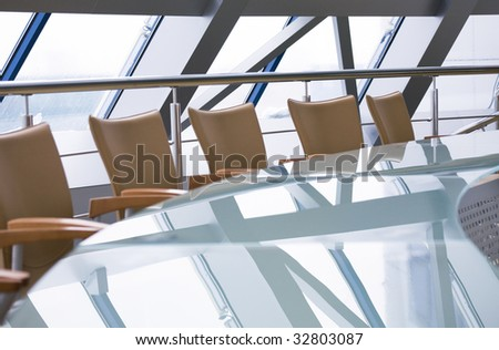Photo of glassy table with chairs in the office